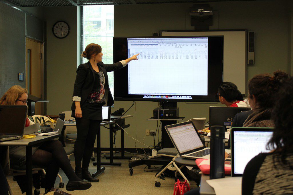 Neptis researcher and transportation engineer, Erin Toop, explains statistics during a Senior Reporting data journalism workshop at Ryerson University on Oct. 9.