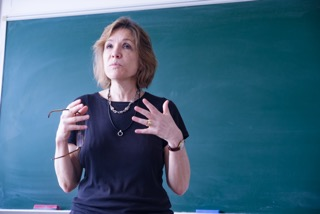 Anne McNeilly teaches a class at Jinan University in China.